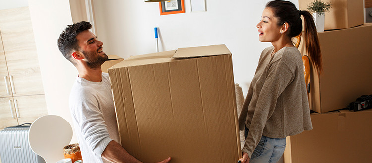 Young Couple Moving Into Their First New Home