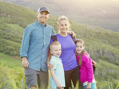 Family hiking a trail to improve health