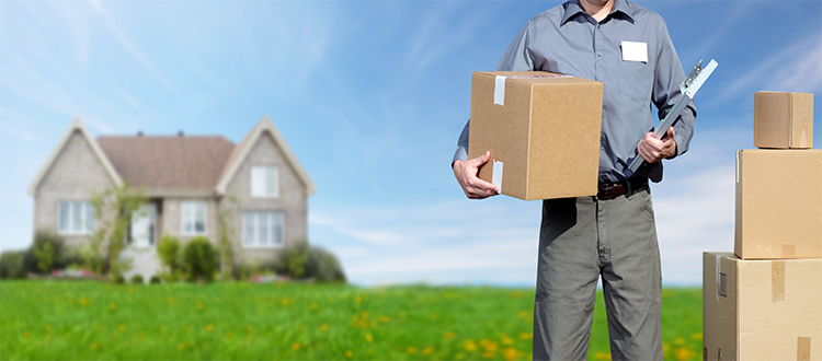 Moving-man-in-front-of-new-home
