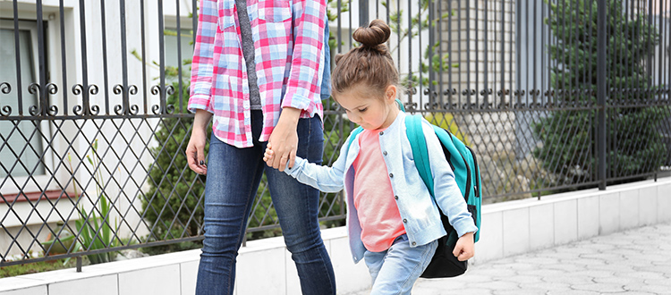 child-going-to-school-with-mom