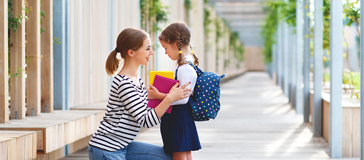 daughter-receiving-words-of-encouragement-before-first-day-of-school